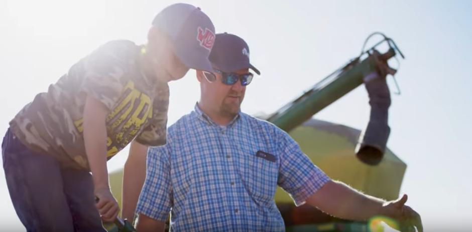 A Washington wheat farmer and his son prepare farming equipment for the field